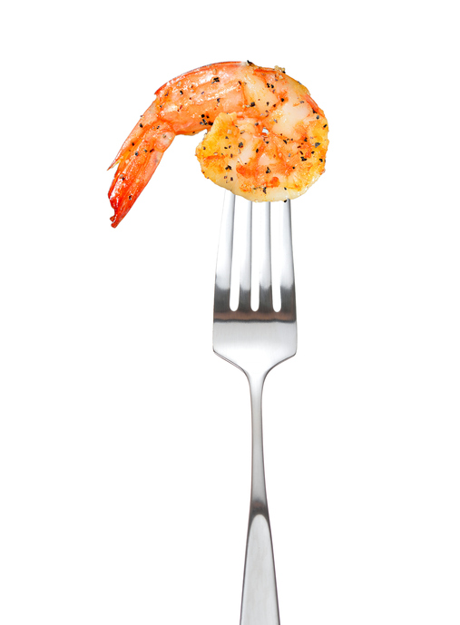 Cooked shrimp on fork 626645312 509x692
